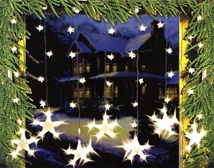 Decorazione Finestre Per Natale : Soggiorno decorato per natale incandescente ghirlande appese alle
