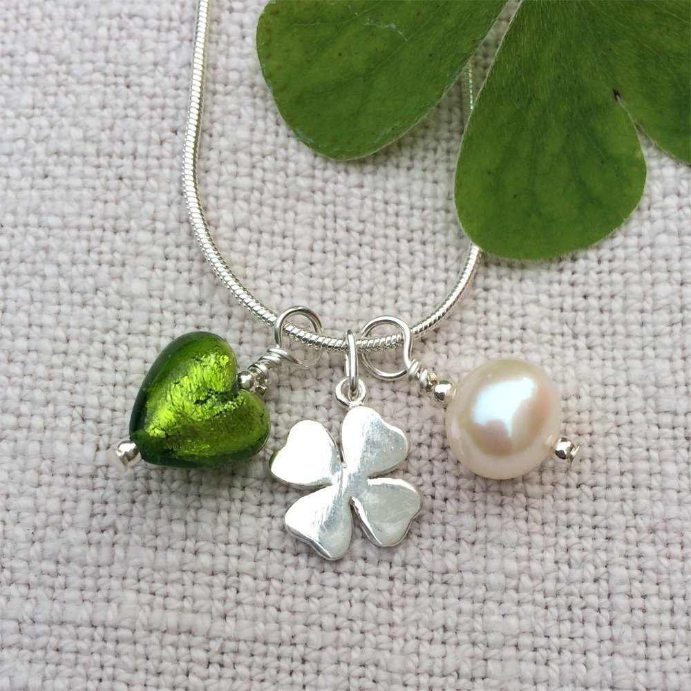 Diana Ingram three charm necklace with olive green Murano glass mini heart (10mm), silver clover and white freshwater pearl on Sterling Silver snake chain.