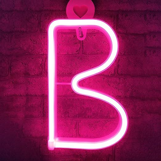 Las letras de neón de LED rosa iluminan el letrero del ...