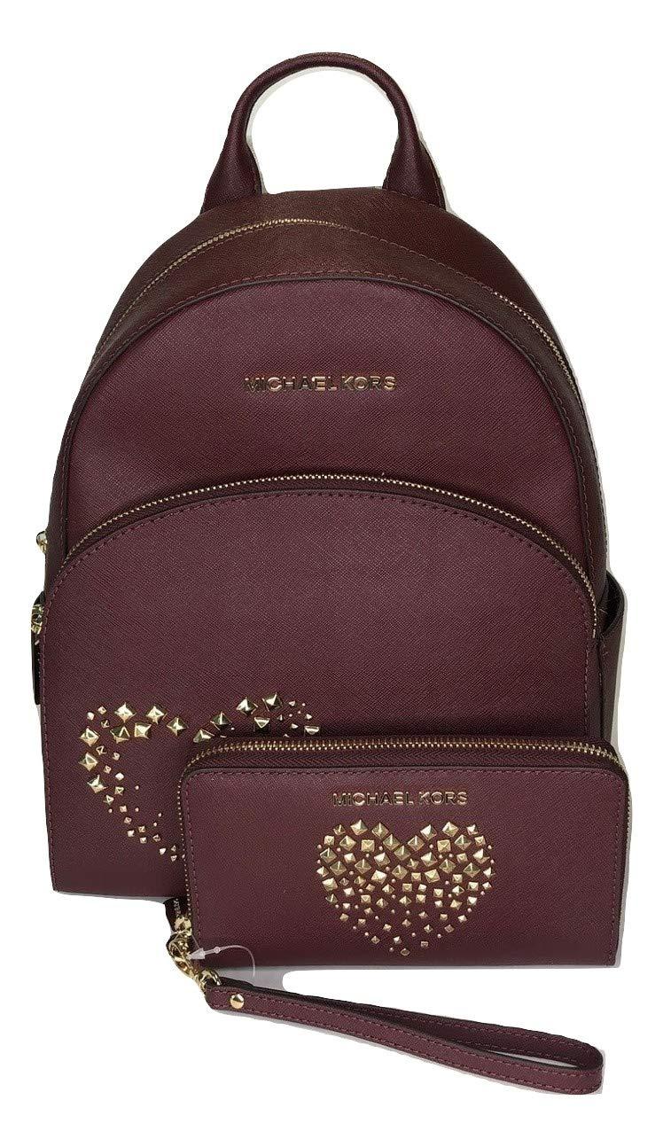 MICHAEL Michael Kors Abbey MD Backpack bundled with Michael Kors Jet Set Travel Flat Phone Wristlet/Wallet (Merlot Studded Heart)