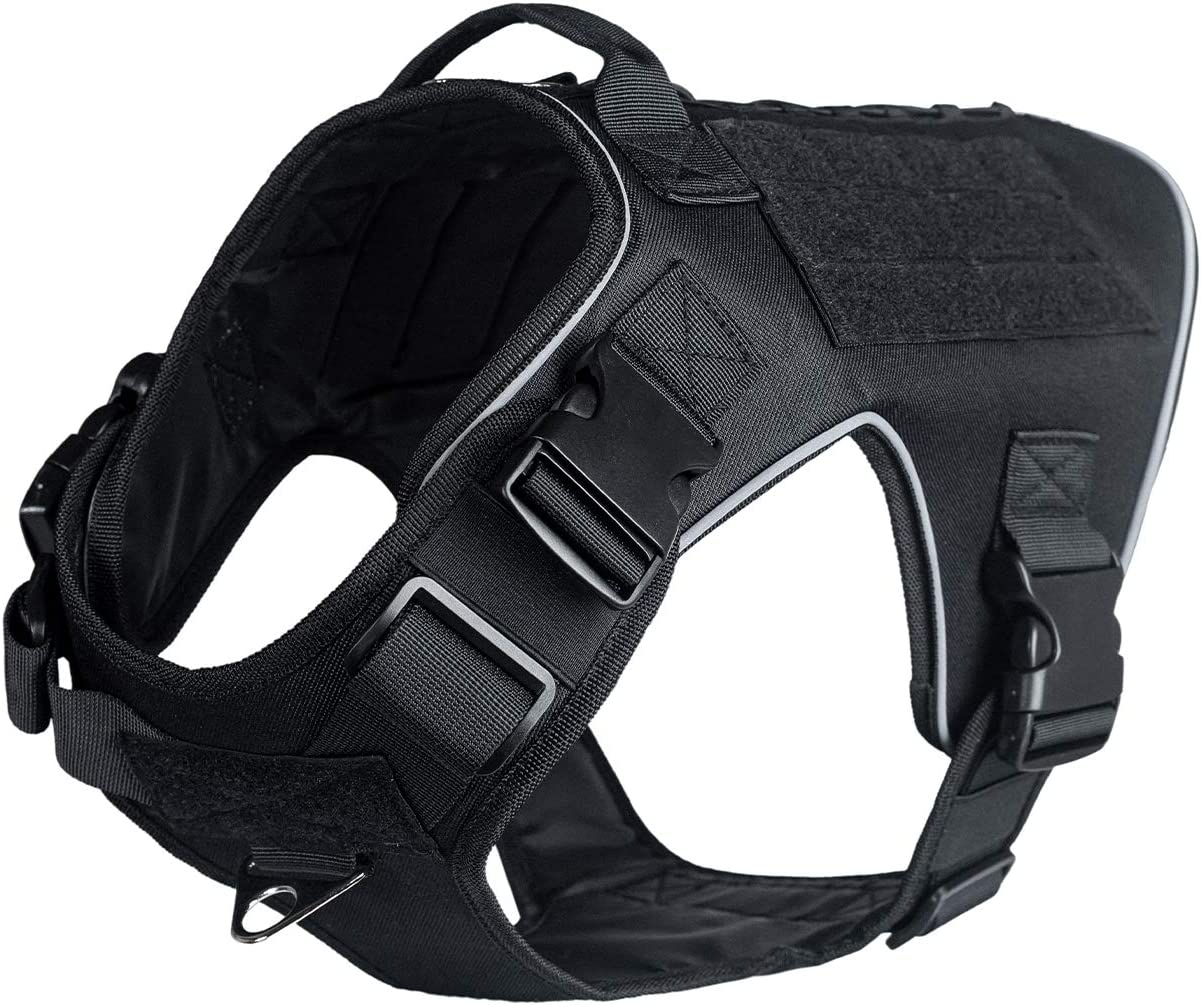 Image of a tactical harness for dogs in color black, with buckles and velcro straps seen clearly.