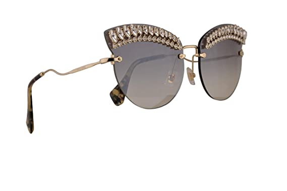 b7a13a51b110 Image Unavailable. Image not available for. Color  Miu Miu MU58TS Sunglasses  Pale Gold w Grey Gradient Mirror Silver ...