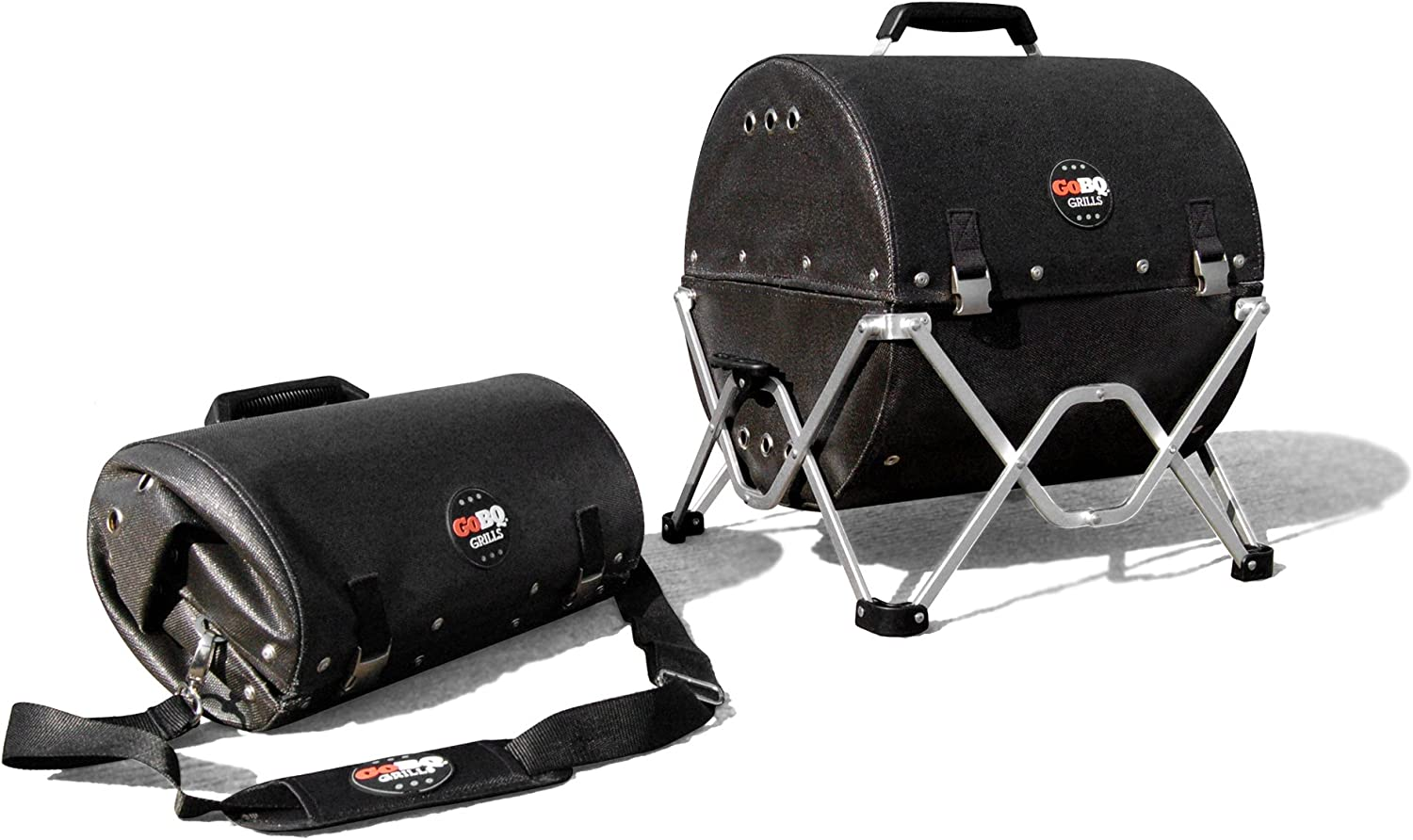 Image of the GoBQ portable charcoal grill with collapsible stand, black, lid closed. with a stroage bag beside it.
