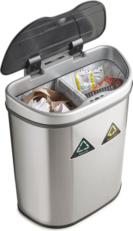 cubo basura automatico de color plateado abierto, con dos compartimentos llenos de basura
