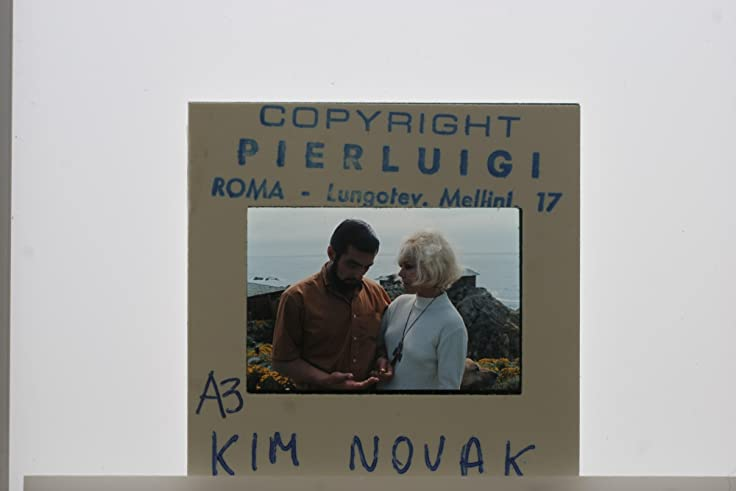slides photo of kim novak with spouse dr robert malloy in a snap