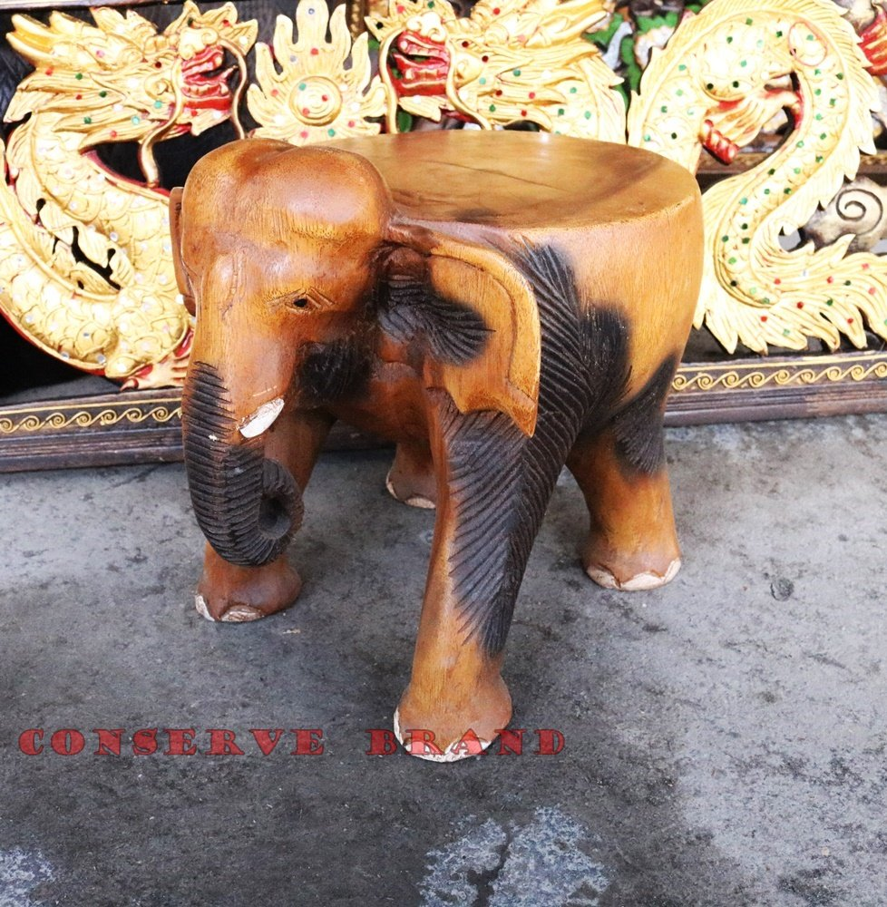 Chang Thai, Elephant Table Diameter 10 inches x Heigh 10 inches Carved Elephant With Livos Walnut Oil Finish. By Conserve Brand by Conserve Brand
