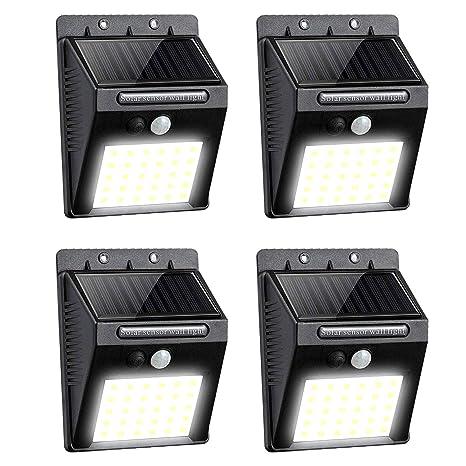 Lavcus 30 LED Luz Solar Exterior Lámparas con Sensor de Movimiento Iluminacion Focos LED Exterior para Jardín Muros Exteriore Patios Terrazas, 4 ...