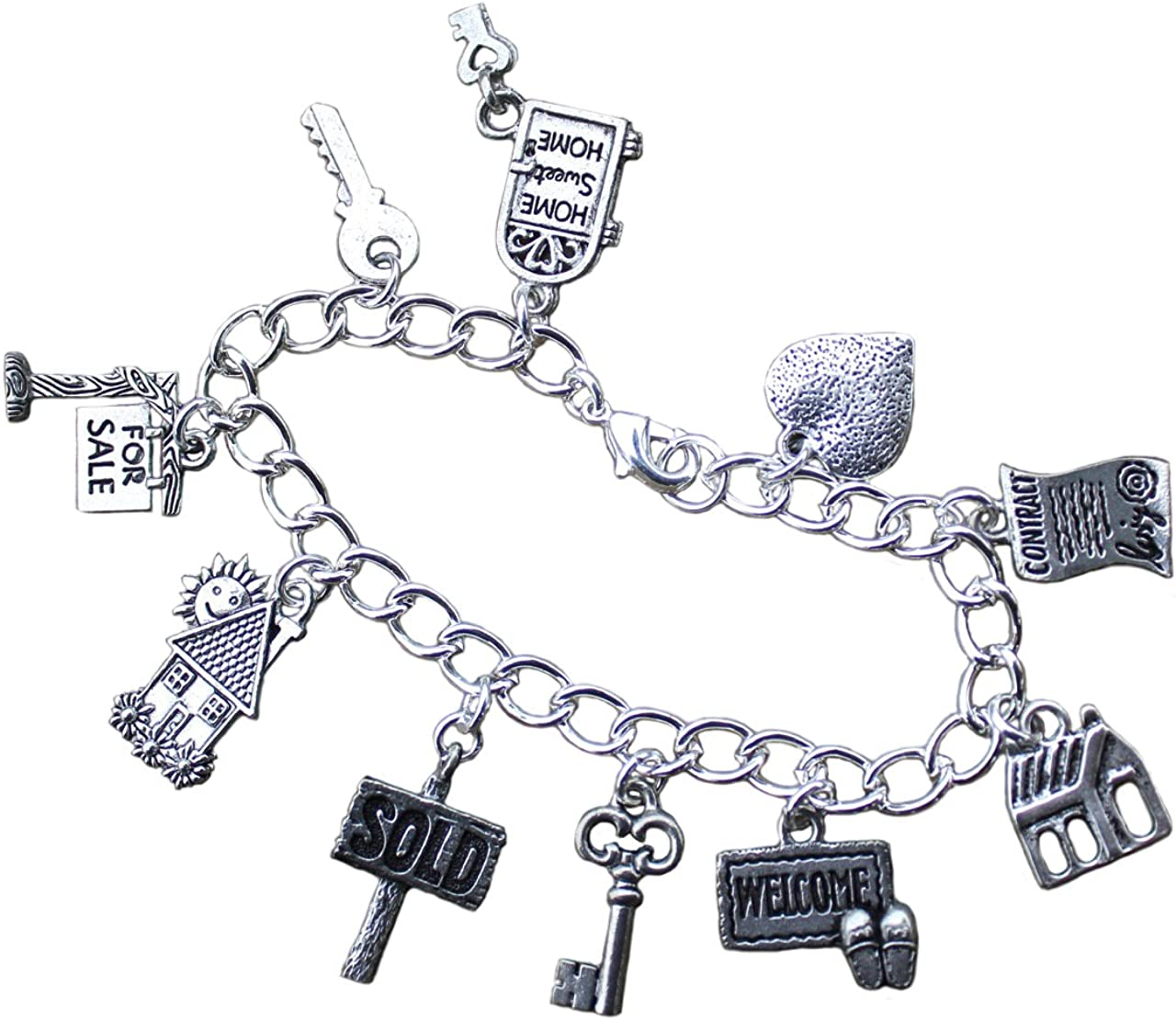 Cute owl charm bracelet Silver plated chain with 5 Tibetan silver charms.