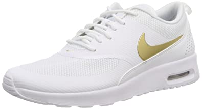 huge selection of 7a8a5 8a777 Nike Womens WMNS Air Max Thea J Gymnastics Shoes, MTLC GoldWhite 100,