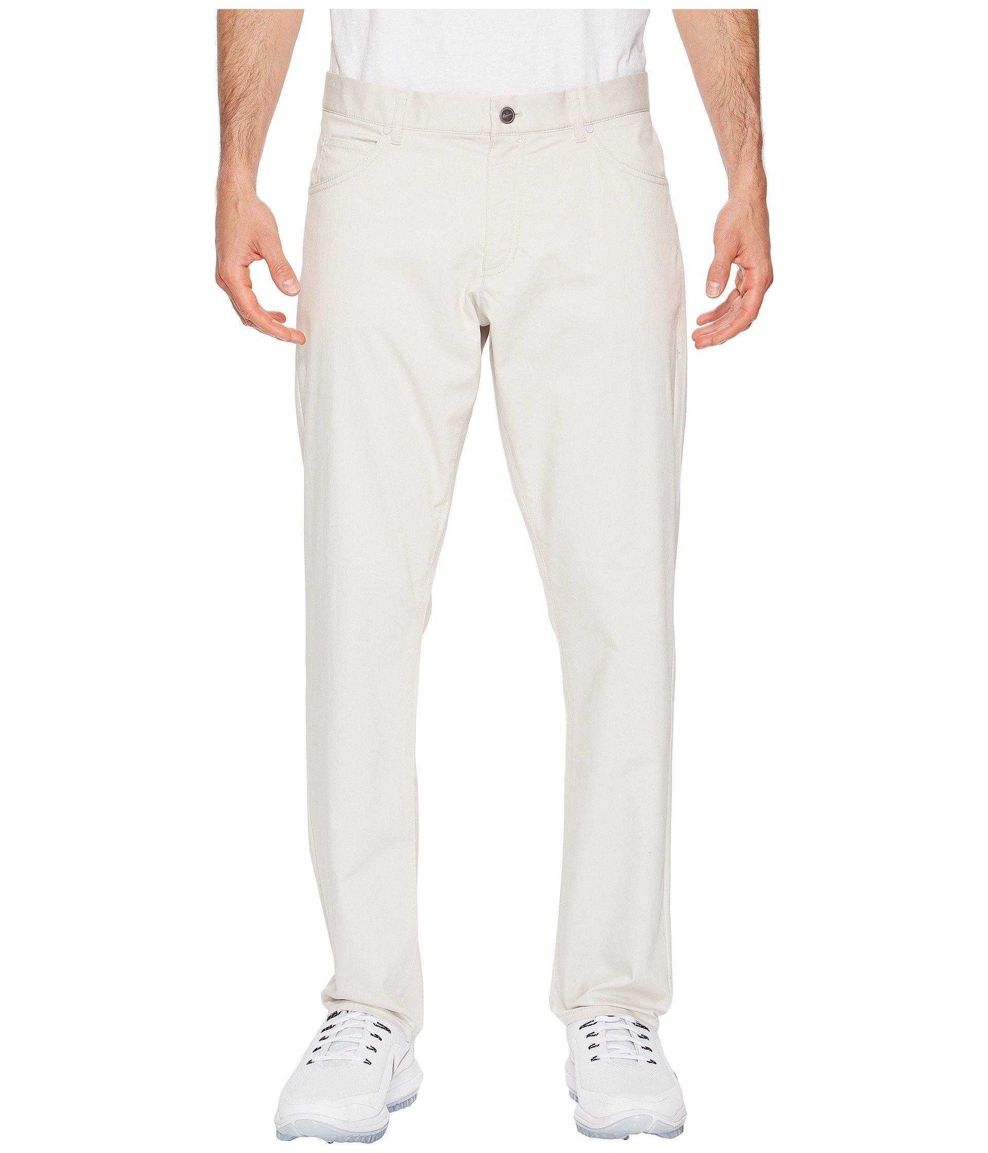 NIKE Men's Flex Slim 5-Pocket Golf Pants, Light Bone/White, Size 35/30 by Nike