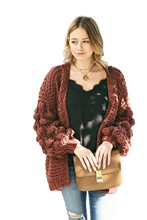 a3bffcc106 Hand-Knitted Pom Pom Sleeve Chunky Cardigan at Amazon Women s Clothing  store