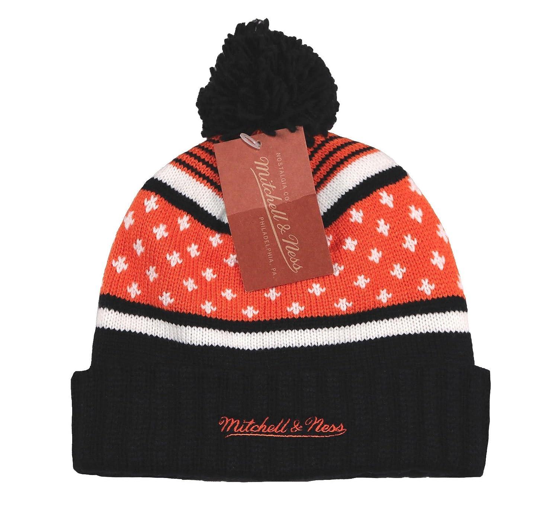 4c8b70a62d6 Amazon.com  Mitchel   Ness Men s Anaheim Ducks Highland Cuffed Pom Beanie  Orange Black  Clothing