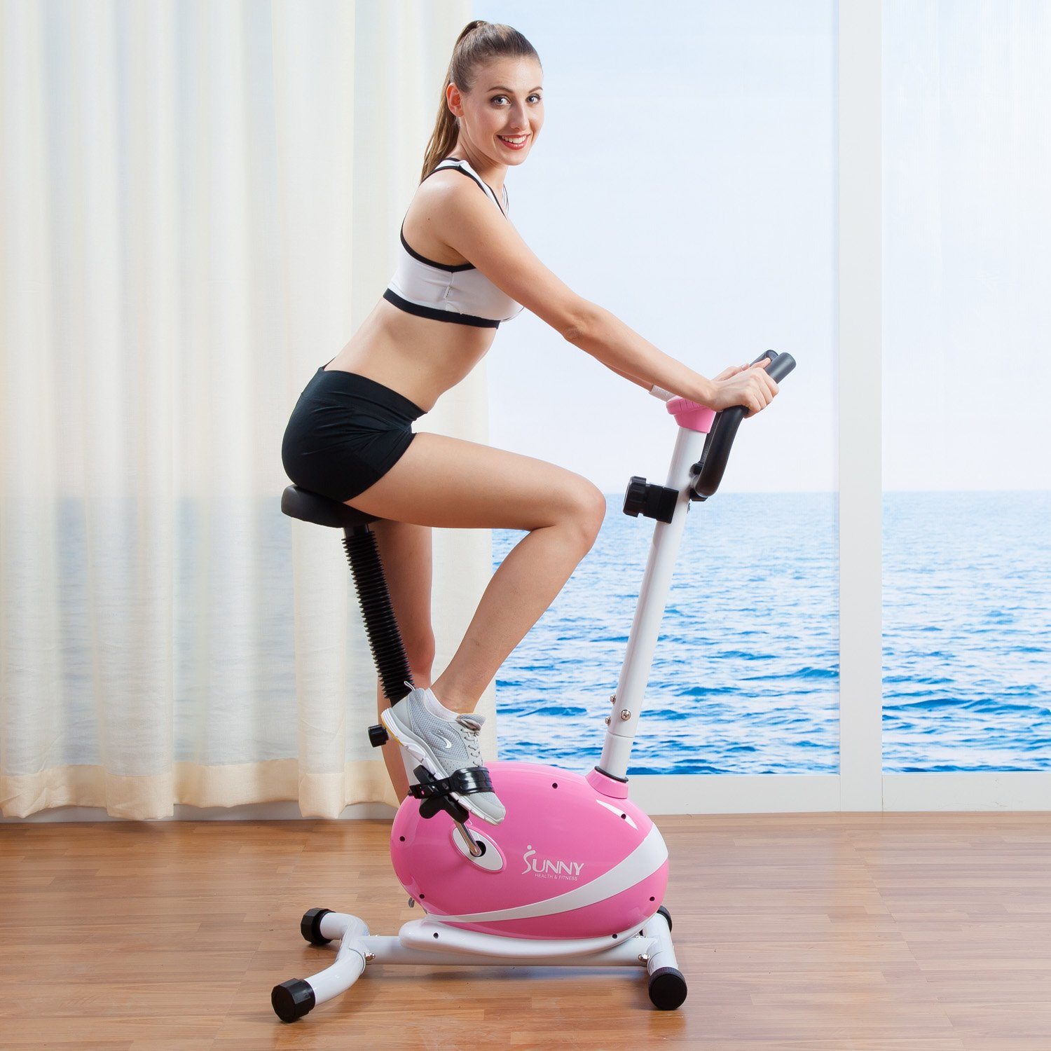 $121.61(was $212.79) Sunny Health and Fitness Magnetic Upright Bike (Pink)