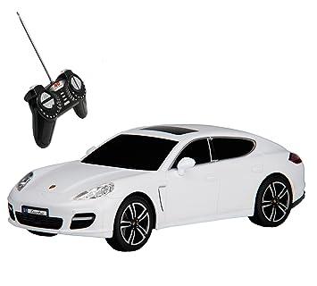 RC Modelo Porsche Panamera Turbo teledirigido con luz 1: 18, color blanco: Amazon.es: Juguetes y juegos