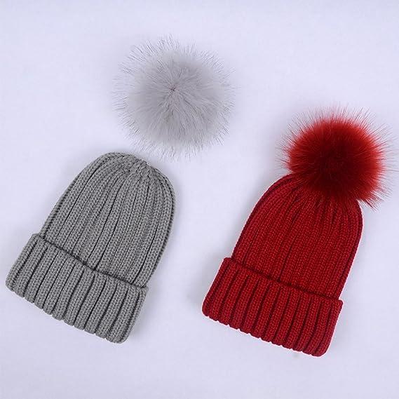 Lau s Berretto a coste donna con pompon in pelliccia sintetica rimovibile  cappelli lavorato a maglia invernali Blanc  Amazon.it  Abbigliamento 6b23c1e8ea10