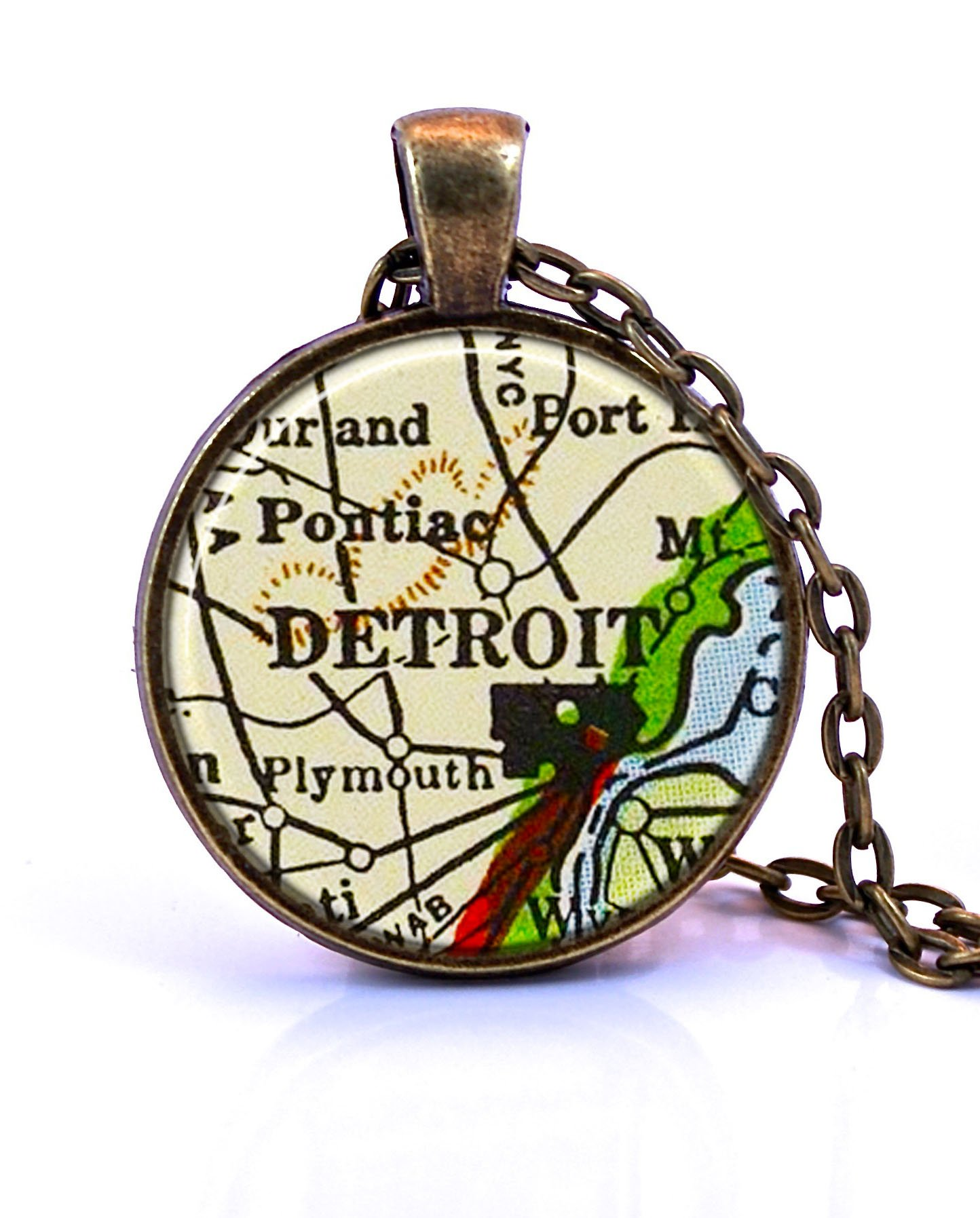 Detroit, Michigan Map Pendant Necklace by Paper Towns Vintage. Detroit necklace handmade from a 1958 vintage map. Map necklace includes adjustable chain and gift packaging. Custom jewelry available.