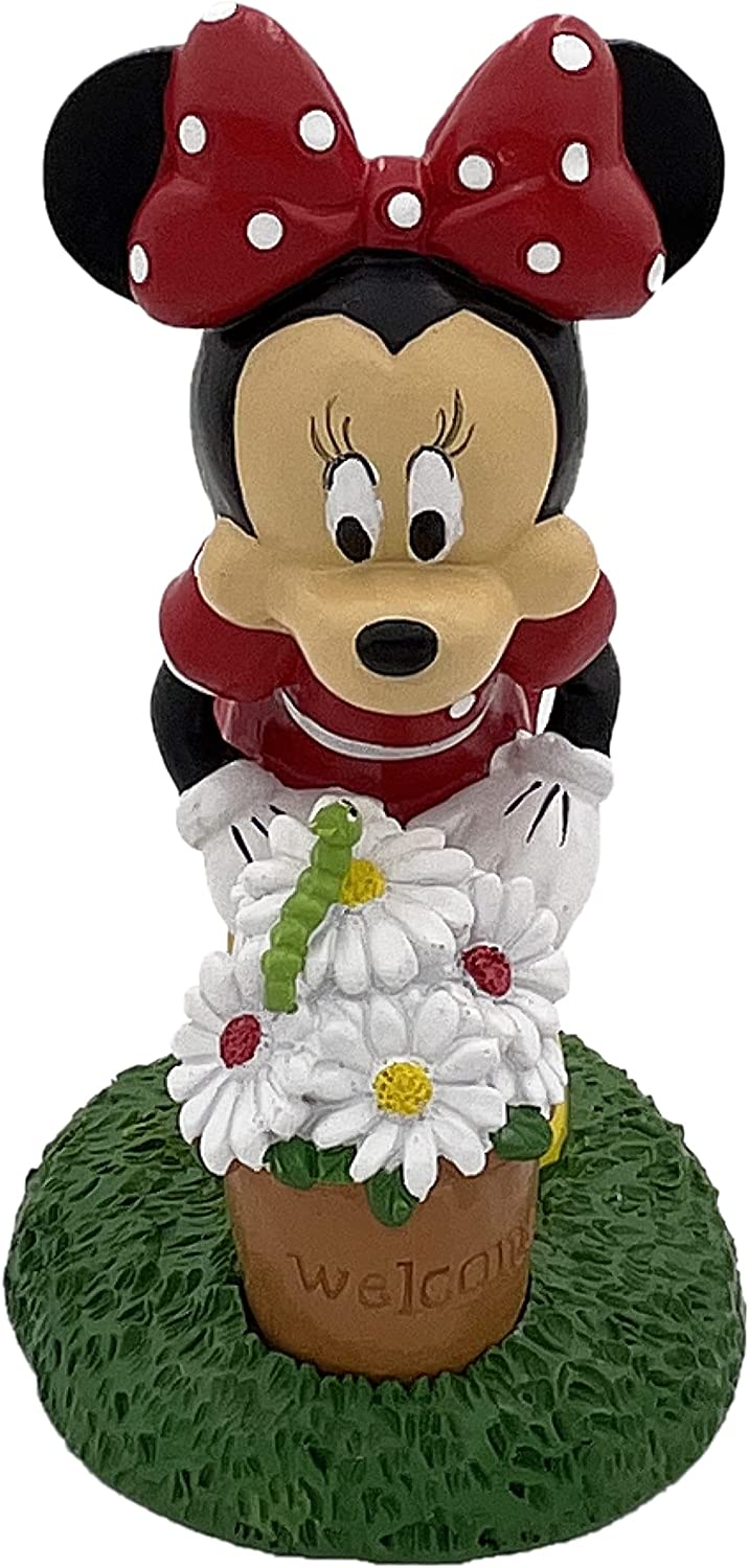 Disney Minnie Mouse is Smelling her Flowers and sees a Bright Green Caterpillar. Minnie Welcomes You to The Garden with Bright Spring Colors. Stands 8 Inches Tall and 5 Inches Wide