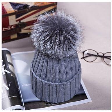 8519019c3ac Poppy world Women Winter Knit Hat Wool Warm Beanie Raccoon Fur Pom Bobble  Crochet Ski Cap (Grey)  Amazon.co.uk  Clothing