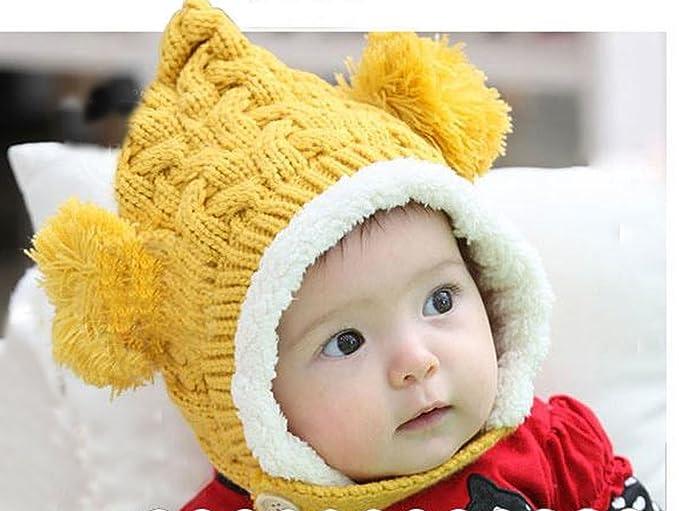 837f879960f Amazon.com  Unisex-Baby Boys Girls Knit Crochet Rib Pom Pom Winter Hat Cap  Warm Winter (Yellow)  Clothing