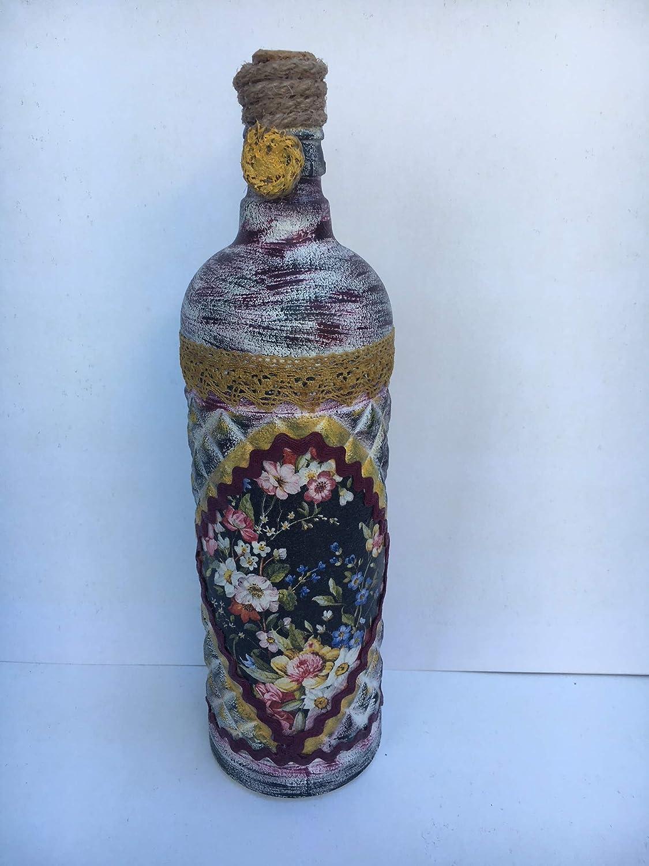 Botella decorativa con adorno de flores