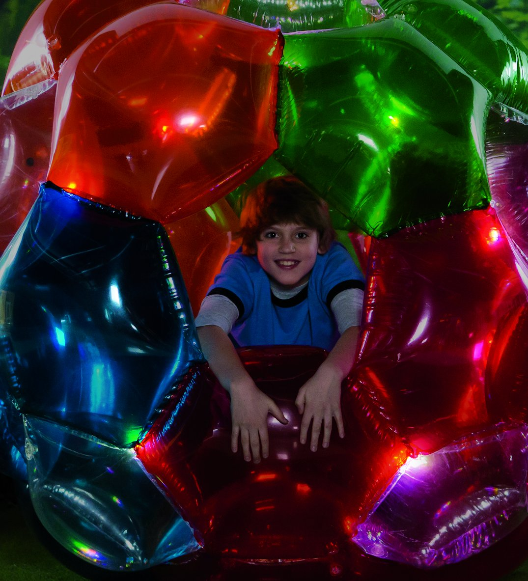 Light Up Multi Color Kaleidoscopic GBOP Great Big Outdoor Play Ball Confetti Filled Motion Activated LEDs Inflatable Durable PVC 65'' Diam by HearthSong (Image #2)