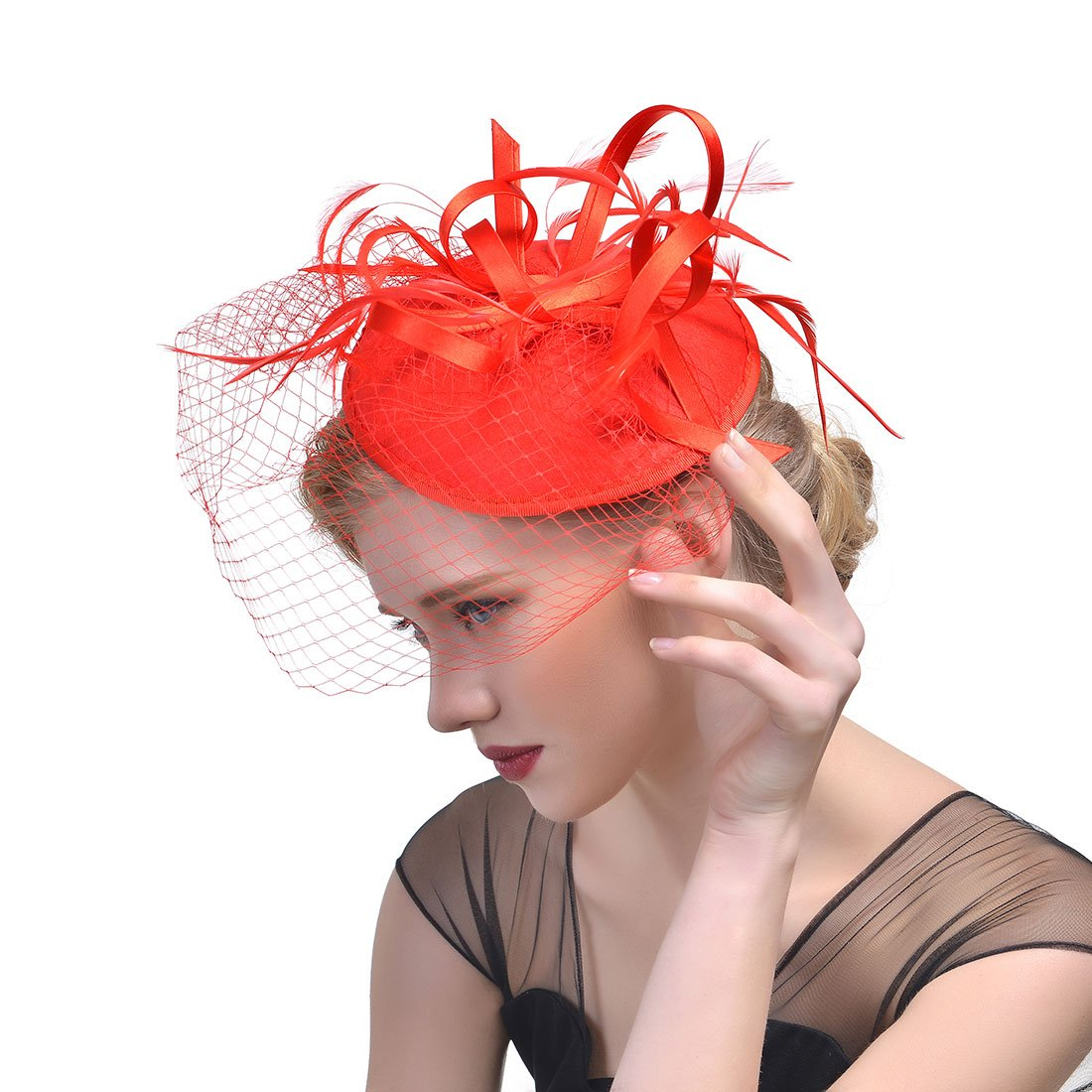 The face covering veil hair feather headdress flower hat