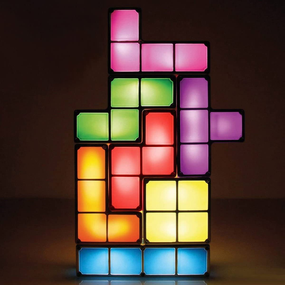 Image of a glowing Tetris lamp made of seven individual light up blocks