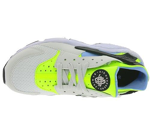the best attitude 8bb82 607b7 Nike Air Huarache, Scarpe da Corsa Uomo, Bianco Verde Blu (off White Barely  Volt-Bluecap), 42 EU  Amazon.it  Scarpe e borse