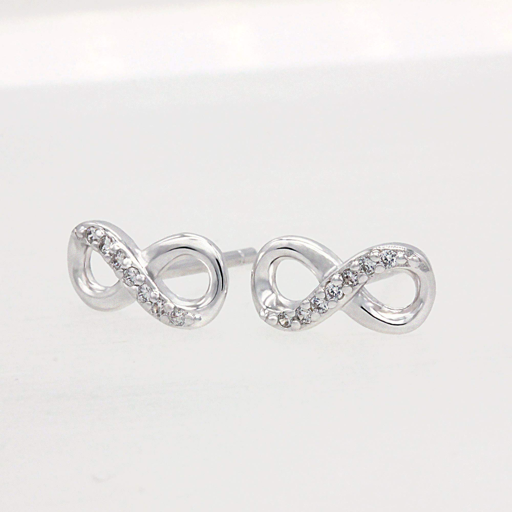 Spoil Cupid Rhodium Plated Sterling Silver Cubic Zirconia Half Set Infinity Stud Earrings