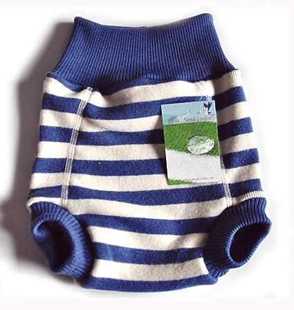 De lana de cubierta sobrepantalón orgánicas de merina es una tipo de pañales de algodón azul