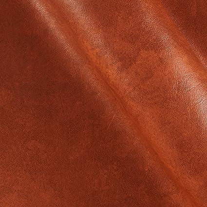 6b07e35f6e Amazon.com  Plastex Fabrics Faux Leather Caprice Bourbon Fabric by ...