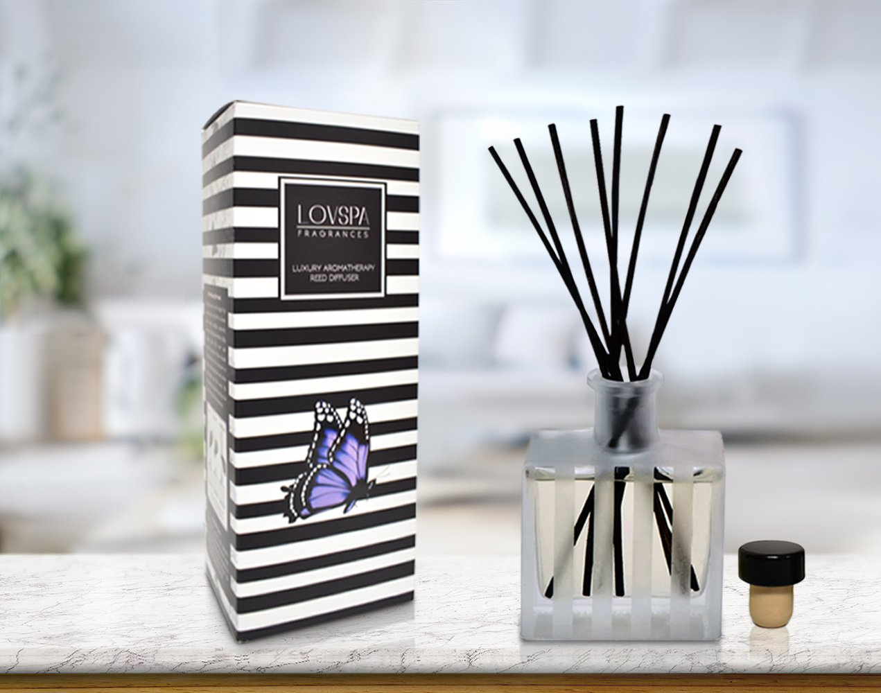 LOVSPA White Tea Reed Diffuser - Scented Sticks Set - Soothing White Tea Scent Infused with Notes of Woody Cedar and Vanilla - Air Freshener for Large Rooms - Made in The USA by LOVSPA (Image #1)