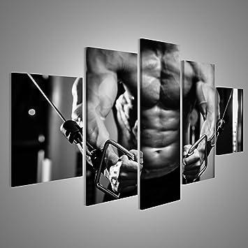 Quadri moderni Bodybuilder ragazzo in palestra pompe fino mani ...