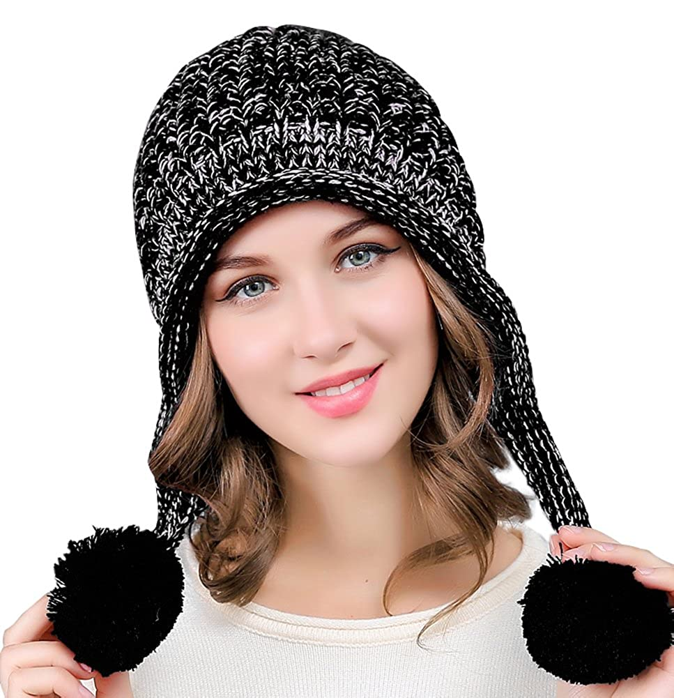64422cd5839 Urban CoCo Women s Winter Cable Knitted Pom Pom Beanie Hat Earflap Caps  (Black) at Amazon Women s Clothing store