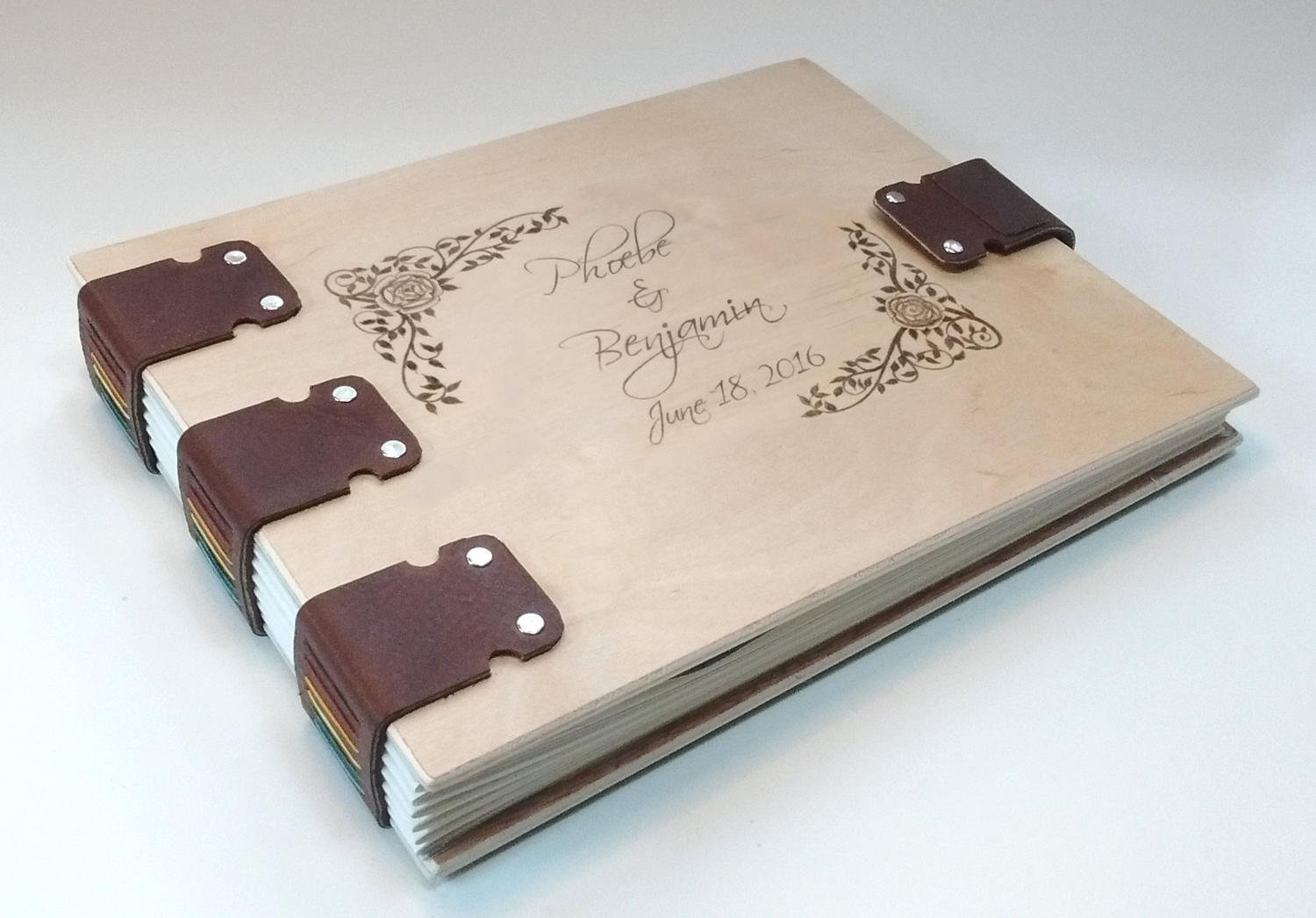 Personalized wedding album, guest register, guest book, photo album, hand-bound in wood and leather, with names and/or decorations engraved on the cover
