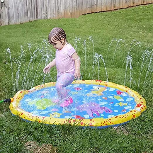Los niños rocían y la almohadilla de salpicadura la alfombra de juego de agua, cojín de
