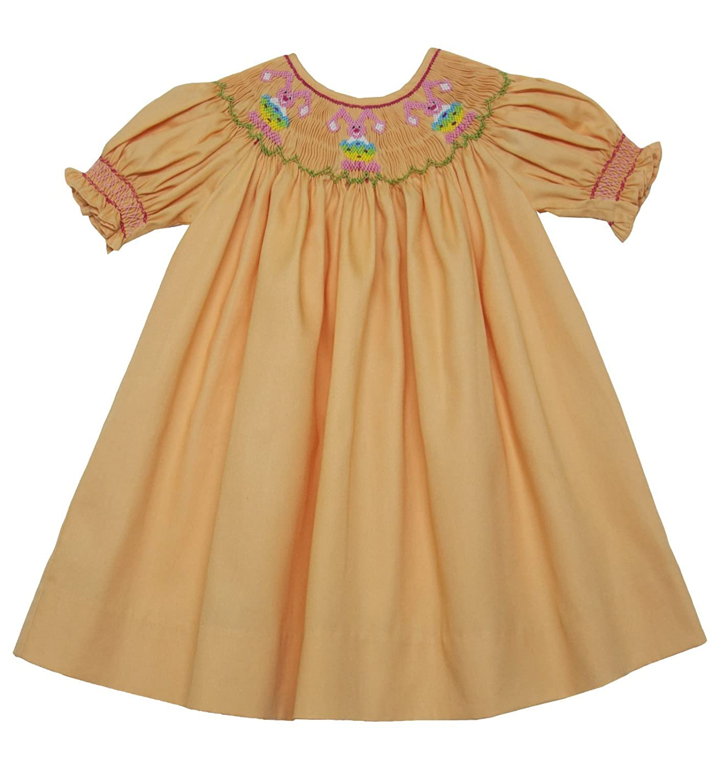 ec5318024 Sweet Smocked Easter Bunny with Eggs Dress on a beautiful pink check fabric  with white ric-rac on the sleeves and collar. The length falls around the  knee.
