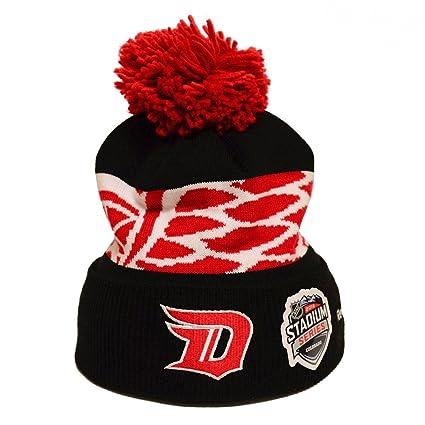 69f77c55b85 Amazon.com   Reebok NHL 2016 Stadium Series Cuffed Knit Hat with Pom ...