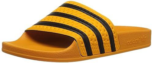 timeless design f6b62 7f17f adidas Originals Adilette Uomo Slip-on Diapositive, Oro (Real Gold S, Core  Black, Real Gold S), 39.5 EU Amazon.it Scarpe e borse