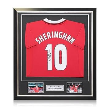 exclusivememorabilia.com Camiseta de fútbol Manchester United firmada por Teddy Sheringham. En Marco de