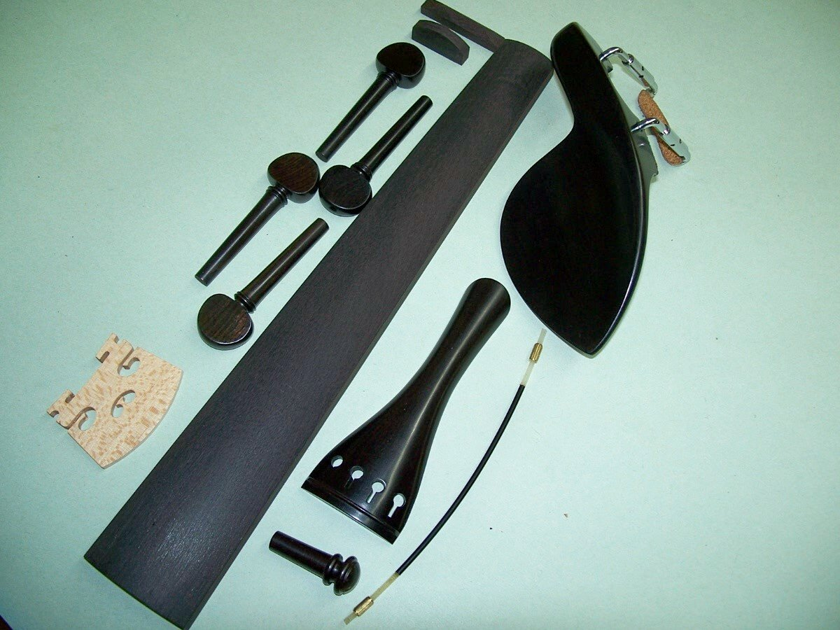 A 4/4 Violin Set of Ebony Parts: Guarneri, French Pegs, End Pin, Tailpiece, Bridge Nut/Saddle, Gut VWWS
