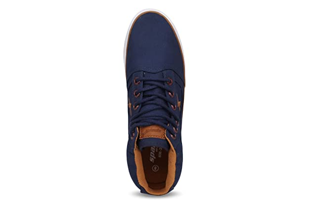 3bf7f83799479 Sparx Men s Navy Blue Tan Canvas Shoes -8 UK  Buy Online at Low Prices in  India - Amazon.in