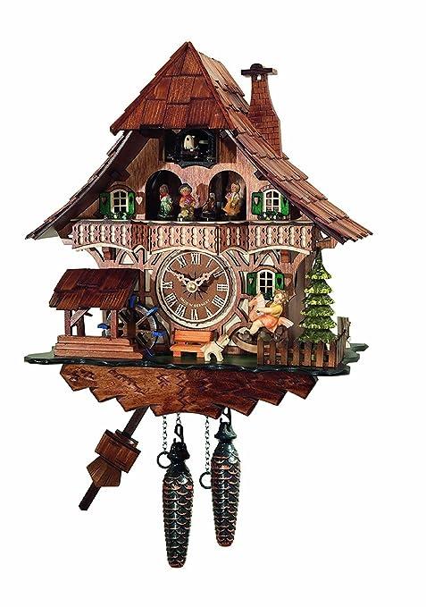 Orologio a cucù, casa della Foresta Nera con la ruota di mulino ...