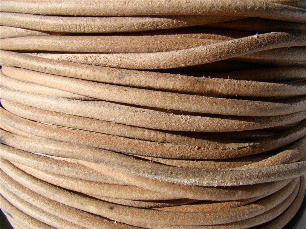 Cordón de piel, 5 m,redondo con 5,0 mm de diámetro,color natural.