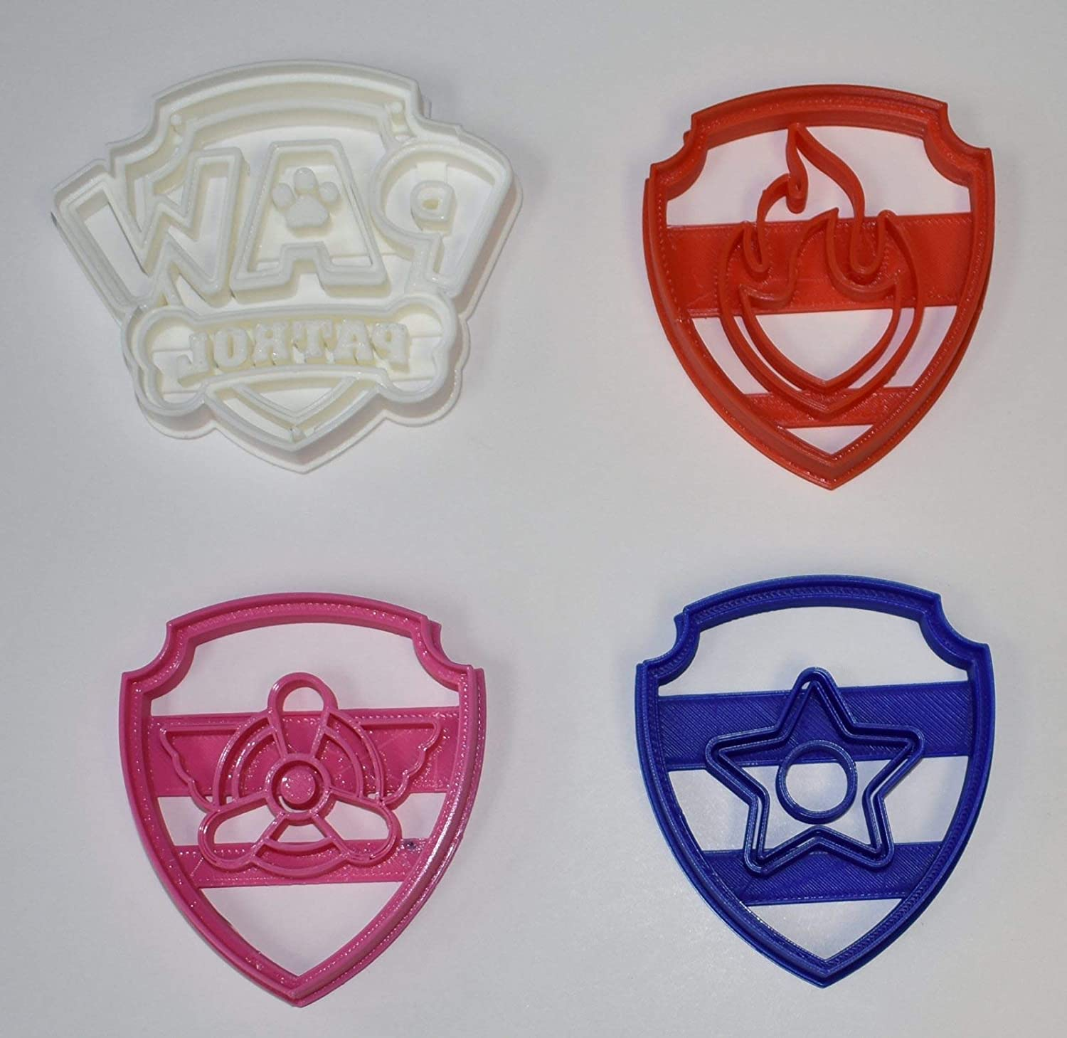 Amazon Com Paw Patrol Logo Badge Shield Tags Chase Marshall Skye Heroic Rescue Pups Dogs Kids Cartoon Set Of 4 Special Occasion Cookie Cutters Baking Tool Made In Usa Pr1047 Kitchen Dining