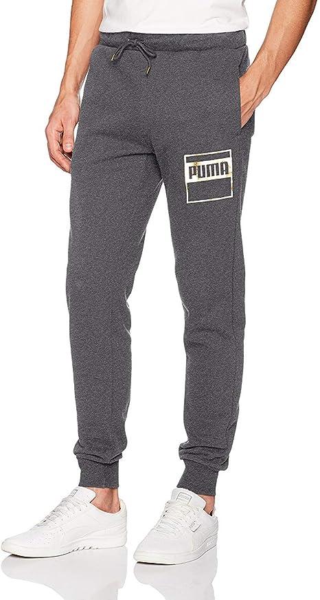Puma pantalones de chándal para hombre Rebel dorado forro polar ...