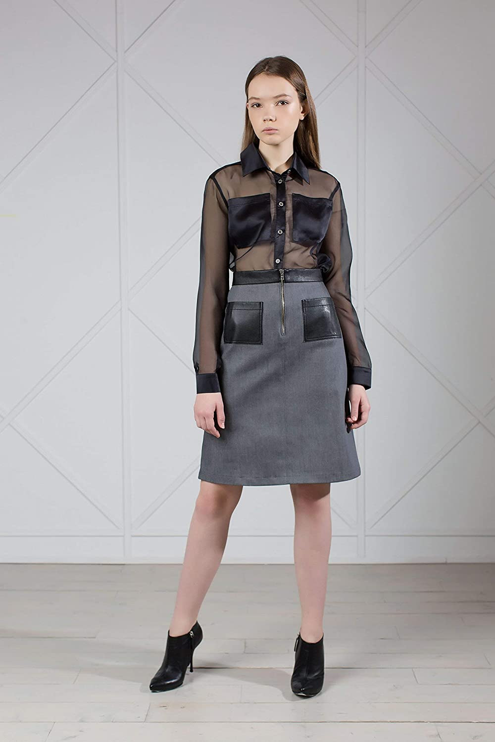 70ddef4a3a Gray denim knee length skirt with black leather pockets and belt. It has a  \'70s-inspired A-line trapeze silhouette, midi length and high waist are ...