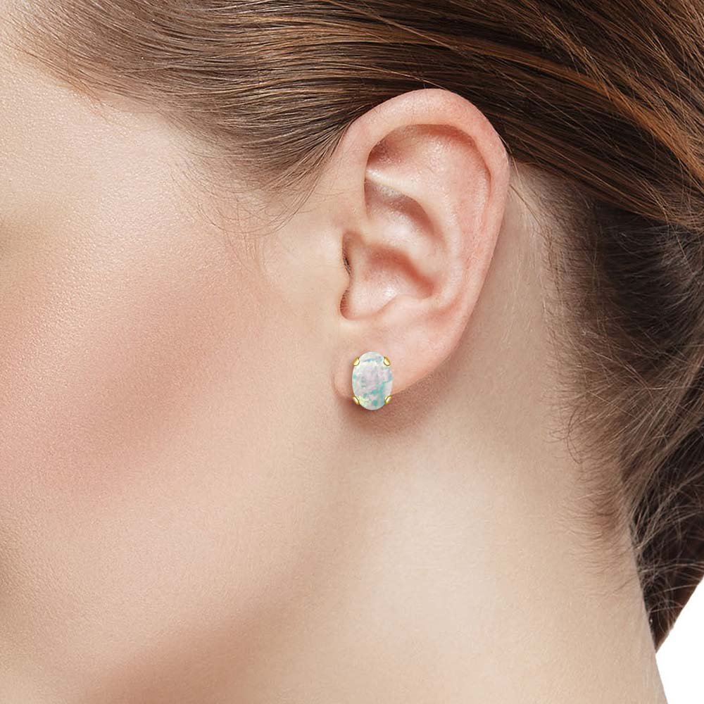 Gem Stone King 1.26 Ct Oval Cabochon 7x5mm White Simulated Opal 14K Yellow Gold Stud Earrings