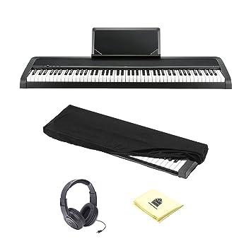 Korg b1bk 88-Key Piano Digital con mejorado sistema de altavoces en color negro con auriculares estéreo, Protector contra el polvo, banco de teclado y ...