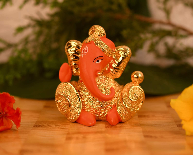 CraftVatika 24 K Gold Plated Red Terracotta Ganesha Statue for Car Dashboard Lord Ganesh Ganpati Idol with Gift Box Home Office Decor(Size 7 cm x 6 cm)